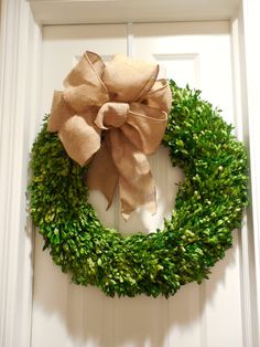 burlap bow on boxwood wreath