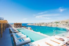 Super Paradise Suites Mykonos is the ideal boutique hotel to take over with your hens ✈️ Super Paradise Beach, 2 Twin Beds, Pool Bar, Beautiful Pools, Comfy Bed, Beach Bars, Mykonos, Front Desk, Swimming Pools