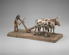 Model of a Man Plowing    Period:Middle Kingdom  Dynasty:early to mid-Dynasty 12  Date:ca. 1981–1885 B.C.  Geography:From Egypt  Medium:Painted wood  Dimensions:H. 20 cm