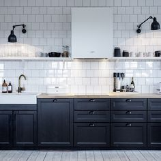 Black and white kitchen with swing-arm lighting