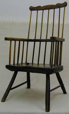 Cardiganshire comb back armchair.