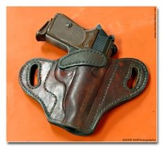 How to make a leather holster tutorial, could use it to figure out how to make a faux leather one. ^_^