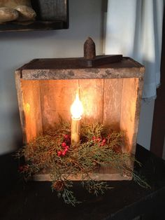 Primitive Candle - grubbied dollar store electric candle with silicone bulb in a wooden box with greenery. Primitive Christmas Decorating, Prim Christmas, Christmas Candles, Country Christmas, Vintage Christmas, Christmas Holidays, Christmas Decorations, Primitive Decorations, Xmas