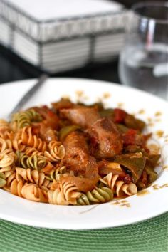 Slow Cooker Sausage And Peppers -- Your house will smell absolutely delicious while your slow cooker is working it's magic with this easy, family friendly and healthy recipe. Use nitrate-free chicken or turkey Italian sausage, and serve with phase-appropriate pasta (leave out the optional pesto for Phase 1)