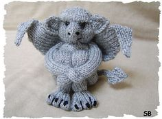 Knitted gargoyle!  He is sooooo freakin adorable!  I want one!  Or a crochet pattern for him!