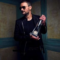 Eric with his CMA for Album of the Year for Mr Misunderstood