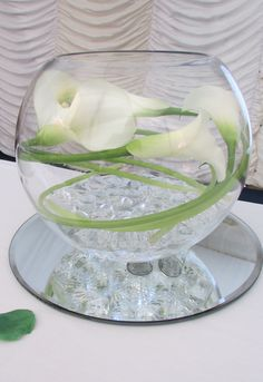 Goldfish bowl with calla lily and lights for wedding table decoration & White Gerbera with pink | Table Centrepieces for hire for weddings ...