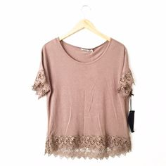 Chloe K Crochet Trim Short Sleeve T-Shirt Brand new with tags. Size XS. Fits true to size in my opinion. Super cute piece for summer! First picture filtered. Slight hi-low hemline. Reasonable offers will be considered through the offer button. Chloe K Tops Tees - Short Sleeve