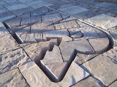 Logo or name cut into pavers, great idea for an entrance.  www.willowrivertree.com