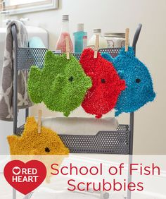School of Fish Scrubbies Free Knitting Pattern in Red Heart yarns -- Learn your colors as you play with these fun fishies in the tub or washing up at the sink. Of course, adults with coastal decorating themes will love these scrubbies too! Knit them in a rainbow of colors, use them often and wash them easily in the washer. They air dry quickly!