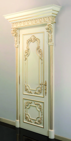 Hinged door with side frames and carved superior capitals is ivory lacquered and decorated with gold leaf.