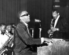 Ray Charles, playing a Hammond, in concert, prob. in 1962; David Newman left, Hank Crawford right (Michael Ochs Archives/Getty).