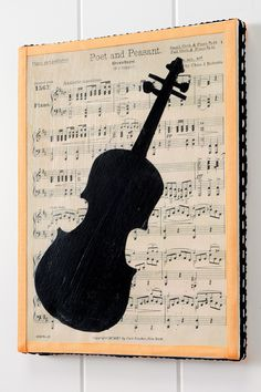 love the use of sheet music in this canvas  A xylophone?  Maybe a maracas or Some other percussion instrument that won't look like an oval silhouette