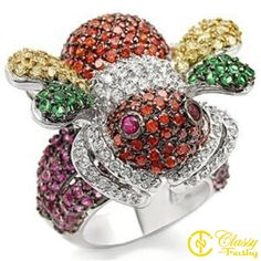 "Classy Not Trashy Women's Fashion Jewelry Ring, Premium Grade Brass Red Synthetic Stone Cluster Ring Size 6. MAKE A STATEMENT! Add sparkle and bling to complement and complete your outfit for your next event. HIGH-QUALITY- Premium Materials used. Includes gold foiled imprinted ""Classy Not Trashy"" gift box with ribbon and soft polishing cloth. GREAT FOR ALL OCCASIONS: Look great while creating memories with loved ones. PERFECT GIFT for any women in your life - mom, best friend, teen girls..."