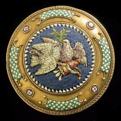 "A late 19th Century gold coloured metal mounted micro mosaic boss pattern brooch in the classical ""Revival"" manner, 35mm overall, the central 25mm panel set with doves, quiver and arrows"