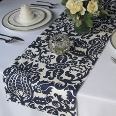 Navy damask runner with white table cloth.