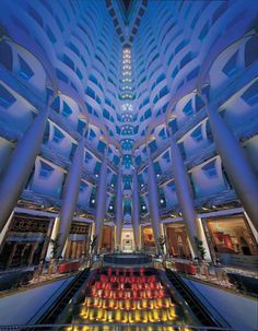 Dubai architecture buildings of the United Arab Emirates : The atrium looking up in Burj Al Arab Hotel Dubai Burj Al Arab, Hotel Dubai, Dubai City, Dubai Uae, Abu Dhabi, Modern Architecture Design, Amazing Architecture, Architecture Interiors, Hotels And Resorts