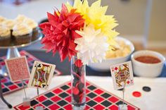 checkers pieces in tall narrow vase for game night centerpiece
