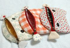 Cat pouches by mairuru_siesta, via Flickr