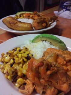 White rice, corn, baked chicken with sweet potatoes and avocado