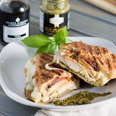 This pesto chicken panini with slow-roasted balsamic tomatoes is crispy, juicy, full of flavor, and oozing with melty cheese!