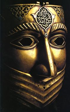 ismael-sarepta:    Iranian battle-mask, from the Safavid Dynasty (16th-18th c.) (Shahada inscribed on the top)  (Scanned by me. Don't remember the source.)  I always thought this mask would make for some rather epic inspiration for a Middle-Eastern cyber-/steam-punk thing.