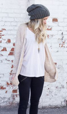 Grey beanie, white tee, oatmeal colored cardigan and black skinnies with front zipper embellishment.