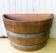 "Lacquer finished Oak wood Quarter Wine BarrelPlanter, 26""W x 13""D x 18""H Master Garden Products http://www.amazon.com/dp/B00GGWRB26/ref=cm_sw_r_pi_dp_8AWIwb07PMSGX"