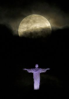 """❥ Photo by: Victor R. Caivano. The """"supermoon"""" appears above the Christ the Redeemer statue in Rio de Janeiro early on Sunday, May 6, 2012. (AP Photo/Victor R. Caivano)"""
