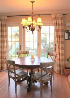 sliding glass door curtain ideas...love the country chairs and the curtains!