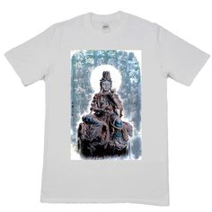 This Buddha t-shirt shows a Buddhist saint with lotus in hand and blue Chinese calligraphy in the background. Get it at https://www.tigerandphoenix.com/shop/awesome-t-shirts/buddha-t-shirt/ !  #fashion #tshirt #tshirtdesign #calligraphy #chinese #buddha