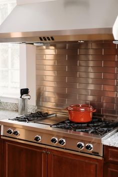 The Tile Shop glass backsplash with stainless steel behind the