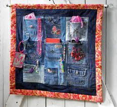 Blue Jean Wall Organizer.  I am going to make one across the headboard of our guest bed, reading lights, small bible, small poetry book and child's picture book, personal Kleenex pack, flashlight, cough drops or mints, pad and pen to write down your dreams.  I LOVE IT!!!!