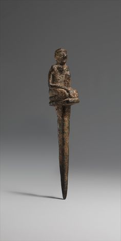Peg with kneeling male  Period:     Early Dynastic Date:     ca. 2900–2350 B.C. Geography:     Mesopotamia Culture:     Sumerian