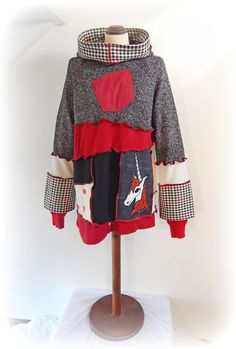 MaiSie Snood Hooded Jumper  Recycled Upcycled - Eco Friendly - Wearable Art Clothing  A alternative handmade jumper created with a unique fabric art Unicorn design. This jumper has an uneven designed hem a snood hood, a chest patch pocket and buttons for decoration.  Main Colours ~ Red, Black, White, Cream.  This jumper is eco friendly and has been made from Recycled Upcycled preloved knitwear and Cashmere jumpers, Denim Skirt, Checked Skirt.  The applique fabric art design has been created…