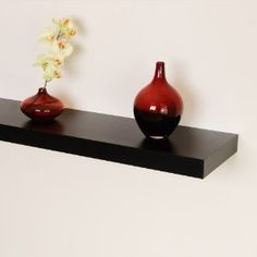 Black floating wall shelf.