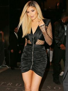 Kylie Jenner wears a lace-panel zip-front minidress