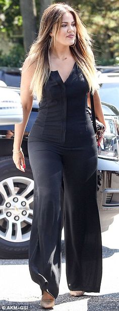 Dressed for summer? meanwhile Khloe was seen wearing a black outfit which featured a corse...