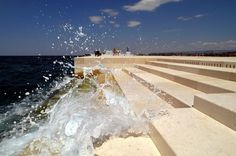 this is the sea organ, found in zadar, croatia. when waves hit tubes found underneath the marble stairs music is created.