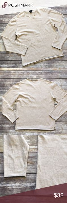 """Guess Ivory Pullover Sweater Guess Ivory Pullover sweater with a hint of Cashmere. Finished with a ribbed hemline and sleeves and a gray trim. Measures pit to pit 21""""/length 26. Made of 90% cotton/ 10% Cashmere Guess Sweaters"""