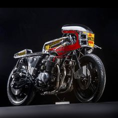 The Daft Punk-esque duo from Vibrazioni Art Design have a penchant for welder's masks—and turning nostalgic gas station paraphernalia into rolling works of art. Pennzoil takes center stage on this industrial CB750 build, which is devoid of anything befitting a garage queen.
