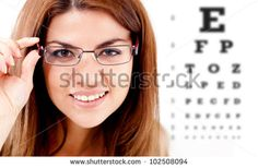Woman taking an eye vision test and wearing glasses