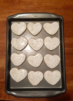 Pretty Valentine's Day heart sugar cookies! Covered 1/2 in sugar crystals and 1/2 in scrolled royal icing. Picture doesn't do these justice!