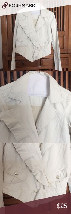Cute CAbi Ruffled Jacket. CAbi very cute linen jacket with front ruffle. It has a 3 front button closure. There are 2 front pockets with buttons. Sleeves have 2 buttons. Excellent condition. CAbi Jackets & Coats