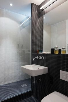 Black Tiles in a simple bathroom : Remodelista