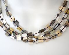 This necklace is simply elegant, I love natural cream tones that go with any outfit.  This is a must have necklace for any bohemian girl. The necklace