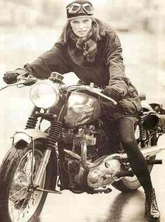 Vintage female motorcyclist. Ready to ride!