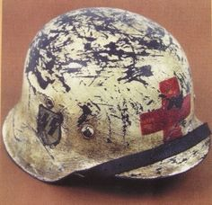 Winter camouflage painted stahlhelm for an SS sanitater (combat medic )