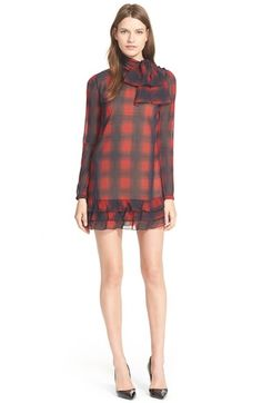 Free shipping and returns on RED Valentino Tie Neck Plaid Dress at Nordstrom.com. Designers Maria Grazia Chiuri and Pierpaolo Piccioli combine girly and grunge influences on this long-sleeve stretch-silk dress in a washed plaid print. A tiered ruffled hemline and oversized tie neckline add feminine shape to the straight, leg-flaunting silhouette.