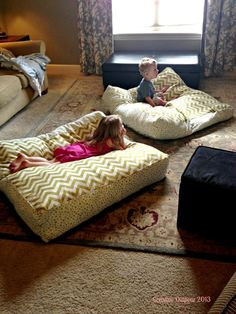 Inspiring Ideas for Stunning Giant Floor Pillow Design: Exciting Family Room Design With Comfortable Giant Floor Pillow With Kids On Them And Cozy Fur Rug And Excellent Light Brown Sofa Ideas ~ nectokin.com Decorating Inspiration